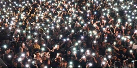 La loi sur l'hymne national menace la liberté d'expression à Hong Kong. © HECTOR RETAMAL/AFP via Getty Images
