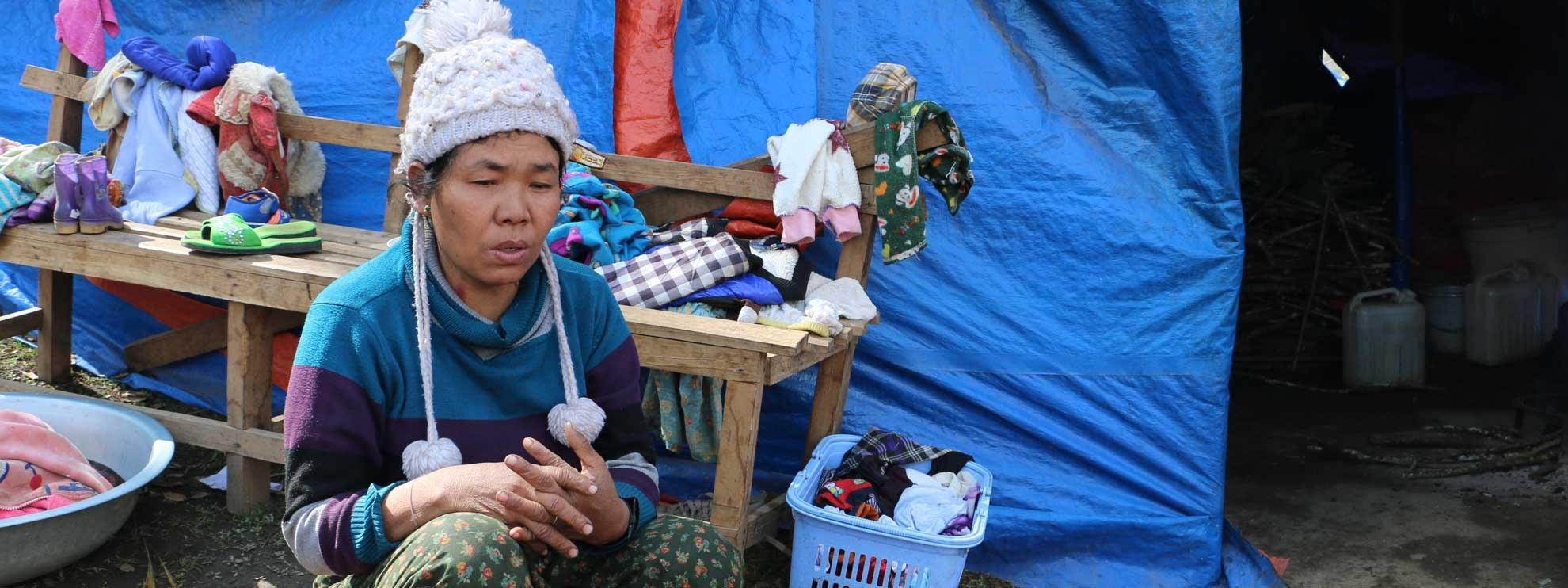 Six ans après son expulsion de son village en 2011, Labang Ja San est toujours coincée dans le camp de réfugiés de Sha It Yang IDP dans l'Etat de Kachin. © AI